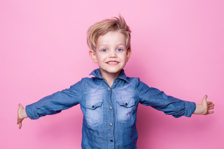 beautiful little boys: Portrait of happy joyful beautiful little boy. Studio portrait over pink background Stock Photo