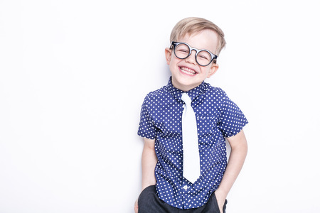 Portrait of a little boy in a funny glasses and tie. School. Preschool. Fashion. Studio portrait isolated over white background