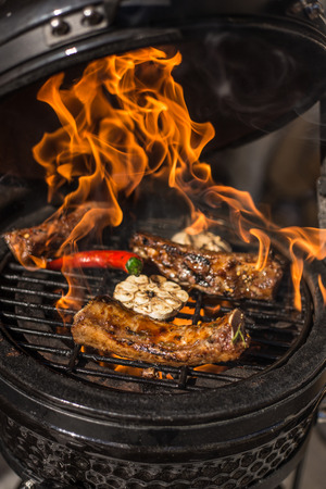 Delicious spicy marinated spare ribs on hot flaming grill