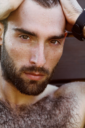 hairy male: Fashion Portrait of handsome masculine guy with drop of water on а face with Brown dark eyes Beard and mustache