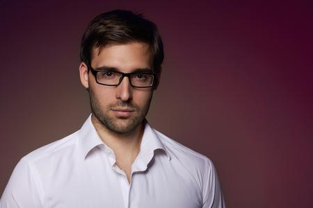 financier: Portrait of handsome smartlooking businesslike Financier or agent or manager in eyeglasses and white shirt Stock Photo