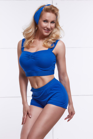 tanned body: Young blonde dressed in style PinUp tanned body fitness sport