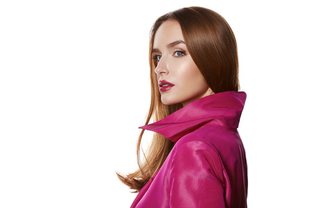 slicker: Beautiful sexy young blond girl with long hair bright evening make-up red lips long fluffy eyelashes in pink cloak joy fun beauty salon clothes shop