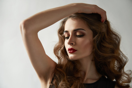 cheekbones: Portrait of young beautiful perfect sexy woman with long smooth hair well-groomed, fashionable styling hair, evening make-up organic cosmetics, facial features in a beauty salon