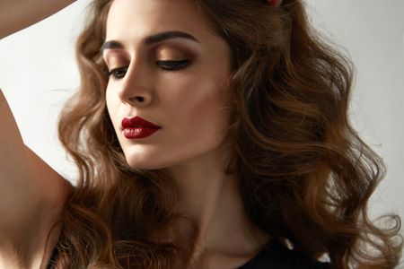 facial features: Portrait of young beautiful perfect sexy woman with long smooth hair well-groomed, fashionable styling hair, evening make-up organic cosmetics, facial features in a beauty salon