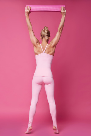 athletic wear: Beautiful sexy blonde woman perfect athletic slim figure engaged in yoga, exercise or fitness, lead healthy lifestyle, wear in comfortable casual clothes pink doll style sport pilates diet body shape