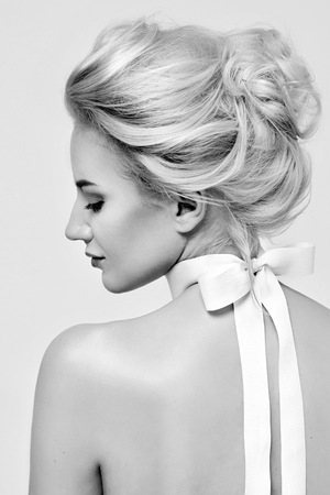 portrait young girl studio: Tender fashion portrait of beautiful gentle young blond woman with silk bow on the neck cosmetics for body face hair pure natural beauty, organic and diet harmony, makeup Stock Photo