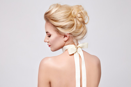 Tender fashion portrait of beautiful gentle young blond woman with silk bow on the neck cosmetics for body face hair pure natural beauty, organic and diet harmony, makeup Stok Fotoğraf