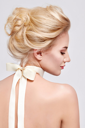 gentle: Tender fashion portrait of beautiful gentle young blond woman with silk bow on the neck cosmetics for body face hair pure natural beauty, organic and diet harmony, makeup Stock Photo