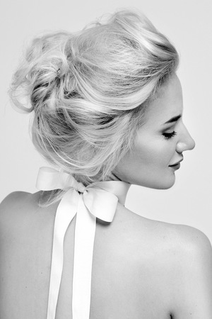 beautiful woman portrait: Tender fashion portrait of beautiful gentle young blond woman with silk bow on the neck cosmetics for body face hair pure natural beauty, organic and diet harmony, makeup Stock Photo