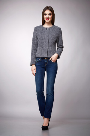 jeans skirt: Beautiful sexy young business woman brunette hair evening makeup wearing dress suit top white jeans skirt high heels shoes business clothes for meetings walks summer fall collection perfect body shape