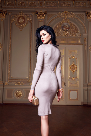 slim women: Beautiful sexy woman in elegant dress fashionable autumn Collection of spring long brunette hair makeup tanned slim body figure accessories interior luxury castle gold monogram baroque palace of Queen