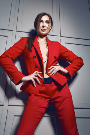 bijou: Beautiful young sexy brunette woman wearing red jacket stylish design and fashionable costume with bijou, beige heels shoes long thin legs, body shape makeup, party design fashion style businesswoman