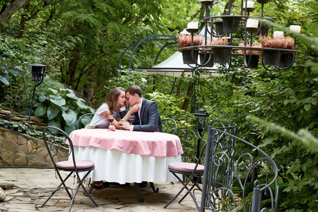 a marriage meeting: Beautiful young couple on a date at a restaurant lunch, flirt talking. Valentines Day holiday of lovers, husband wife, man woman, happy relationship, meeting date, the proposal of marriage, love, hug