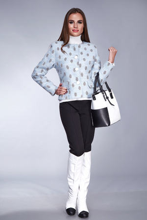 lather: Beautiful sexy woman wear jacket with sweater wool trousers hight lather shoes hold accessory stylish bag fashion stile collection catalogue designers clothes pretty face perfect body shape dark hair
