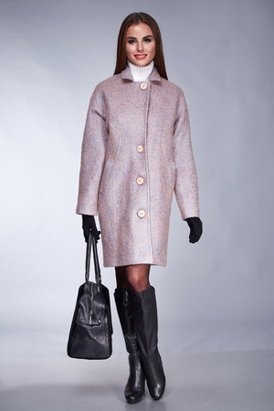 greatcoat: Beautiful stylish woman in an autumn coat, demi leather shoes trend an accessory bag, clothing for fashion-style business meeting, a walk. Stock Photo