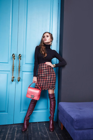 Beautiful young sexy woman lady stylish elegant fashionable blouse and skirt, makeup and hair style for evening business meeting walk date designer with accessories bijouterie high heels lather shoes