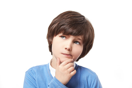 manful: Handsome attractive brunette little boy guy stubble in a checkered sweater leaned his hand to face thought reflects remembers dreams on a white background