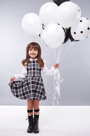 birthday suit: Little girls girlfriend in a beautiful stylish fashion clothes new collection of dress suit, are holding balloons, birthday celebration, congratulations, fun party for kids, dance smile