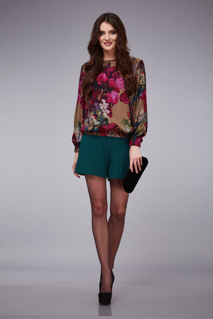 lather: Beautiful young sexy woman lady stylish elegant fashionable blouse and shorts, makeup and hair style for evening business meeting walk date designer with accessory bag high heels lather shoes nylon