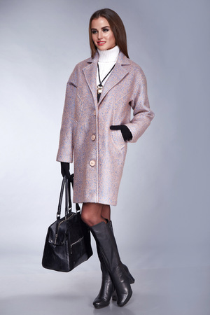 lather: Beauty stylish lady wool coat autumn collection and black lather shoes style look business clothes casual for meeting and sexy woman with long brunette hair and tan skin makeup hold in hand bag glove Stock Photo