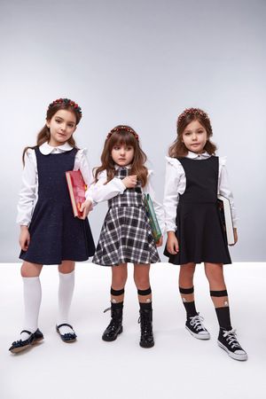 suit skirt: Little girls best friends in a beautiful style fashion clothes collection of dress cute shoes happy birthday celebration, funny party kids, dance smile hug daughter sisters children hold hands