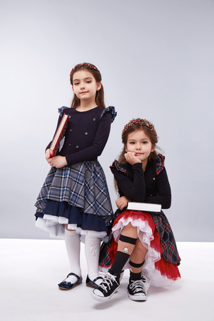 designer baby: Little girls girlfriend in a beautiful stylish fashion clothes  collection of dress birthday celebration, congratulations, fun party for kids, dance smile, holding books, school study, happy children