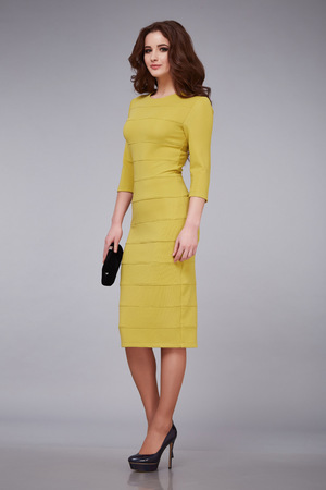 designer bag: Beautiful young sexy woman lady stylish elegant fashionable dress, makeup and hair style for the evening business meeting walk date designer dress with accessories and ornaments high heels hold bag
