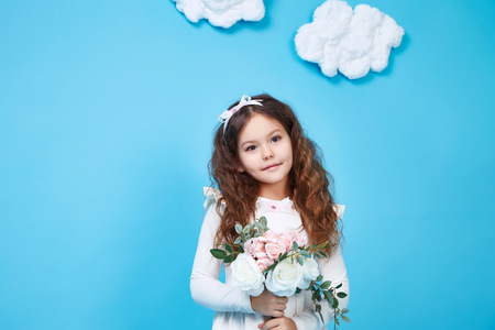children clothing: Beautiful little cute girl smile long dark hair take flower wear style fashion silk cotton dress spring mood children clothing childhood daughter pretty face collection sister friend play fun