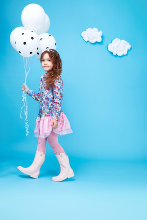 cotton dress: Beautiful little cute girl smile long dark hair take balloons wear style fashion silk cotton dress spring mood children clothing childhood daughter pretty face collection sister friend happy fun