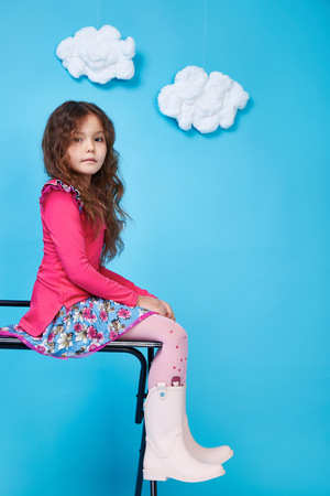 Beautiful little cute girl smile long dark hair wear style fashion silk cotton dress shoe spring mood children clothing childhood daughter pretty face collection sister friend play fun