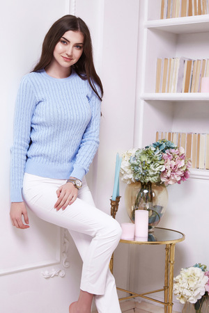date book: Beauty woman clever smart girl read book interview in perfect home interior comfort furniture wear casual fashion wool sweater style pants and clothes for office walk date natural makeup and sexy body