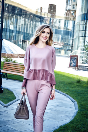 Fashion street style look casual clothes for businesswoman office walk date party busy mom natural texture pink color costume beautiful sexy model smile pretty face long blond hair luxury lifestyle