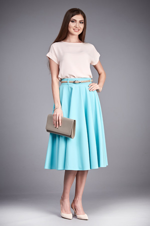 office shoes: Beautiful sexy glamor woman lady long brunet hair makeup wear fashion clothes silk or cotton blouse trendy skirt lather shoes catalog in studio casual office clothes businesswoman accessory body bag. Stock Photo