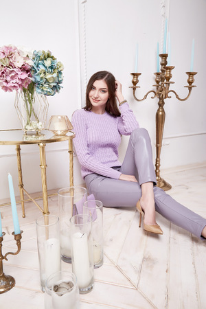silk wool: Beautiful sexy woman wear wool merino sweater silk pants perfect body shape beauty face long brunette hair interior design house room comfortable casual clothes flower candle accessory floor