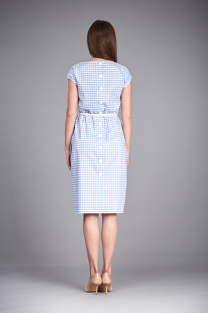 office shoes: Catalog of fashion clothes for business woman mom casual office style meeting walk party silk cotton dress summer collection accessory shoes beautiful model long brunette hair natural make up  back.