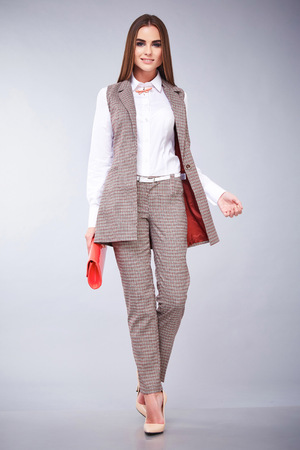 office shoes: Beautiful sexy young business woman brunette hair with evening make-up wearing casual suit office style high-heeled shoes  business clothes for meetings and walks autumn collection perfect body shape
