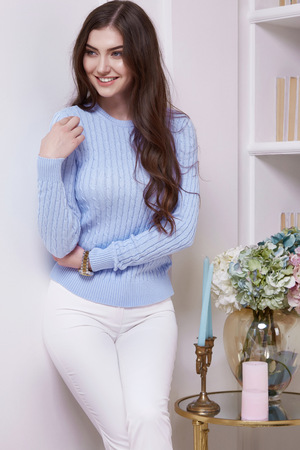 Beauty woman clever smart girl read book interview in perfect home interior comfort furniture wear casual fashion wool sweater style pants and clothes for office walk date natural makeup and body