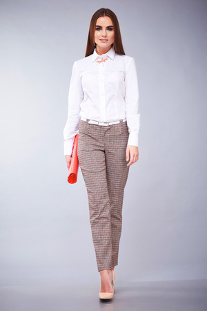 Glamour fashion style beautiful woman sexy clothes white cotton blouse and pants trendy accessory model pose catalog summer collection casual clothes for office businesswoman party date meeting makeup
