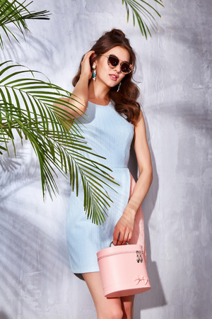 summer wear: Hot summer girl beauty sexy lady wear fashion dress casual clothes party date time model woman luxury life style accessory bag jewelry bijou studio green palm shadow catalog collection pretty face Stock Photo