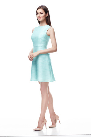 Beautiful fashion model wear silk light-blue short dress for party date office work businesswoman sexy woman pretty face perfect body birthday girl bridesmaid long brunette hair makeup clothes white Standard-Bild