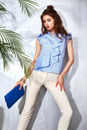hot date: Hot summer girl beauty sexy lady wear fashion blouse and jeans casual clothes party date time model woman luxury life style accessory bag jewelry bijou studio green palm shadow catalog collection Stock Photo