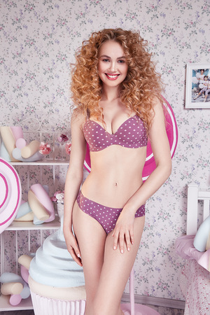 excess weight: Beautiful young sexy blonde woman with curly hair, perfect figure body, wear lingerie silk lace sweets , candy, cake biscuit, marshmallow lose excess weight, diet, proper nutrition, drainage massage