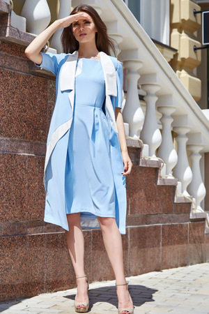 cotton dress: Sexy beautiful woman walk on the city street building fashion luxury style for party date glamour pose summer clothes collection brunette hair accessory model wear blue  cotton dress hairdo Stock Photo