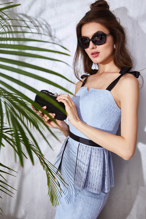 hot date: Hot summer girl beauty sexy lady wear fashion dress casual clothes party date time model woman luxury life style accessory bag jewelry bijou studio green palm shadow catalog collection pretty face Stock Photo