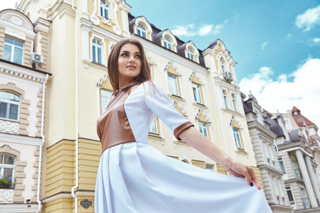 historical building: Beautiful sexy model woman wear stylish dress designer fashion clothes party date casual collection summer weather style pose hairdo walk on the city street historical building model pose makeup