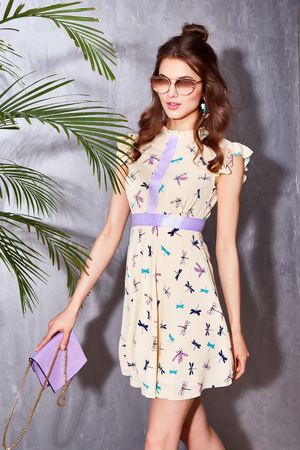 Portrait sexy beautiful woman luxury chic fashion sunglasses trendy jewelry style for party date glamour pose summer shadow green palm clothes dress blouse collection brunette hair accessory model
