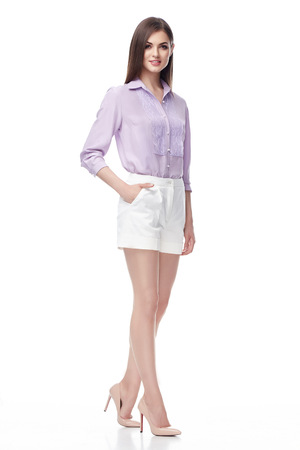 office shoes: Beautiful sexy woman brunette long hair wear lilac silk blouse and white cotton shorts shoes, fashion model business style clothes for office, casual meeting, catalog on white background collection