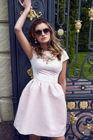 lather: Beauty sexy woman fashion model business woman glamour clothes casual pink dress for party office style accessory lather bag and silk brand sunglasses street look garden yard green trees golden gate