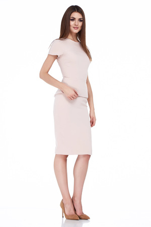 office uniform: Fashion style woman perfect body shape brunette hair wear light beige dress suit elegance casual beautiful model secretary air hostess diplomatic protocol office uniform stewardess business lady.